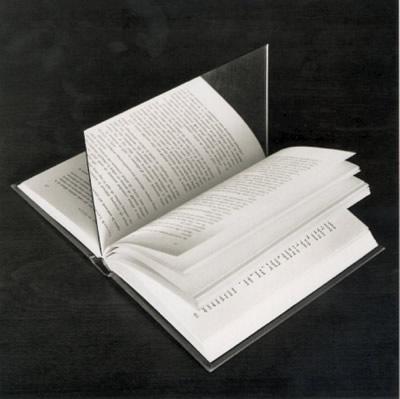 <strong><font size=4>*/ Un libro de poesía ...</strong></font>